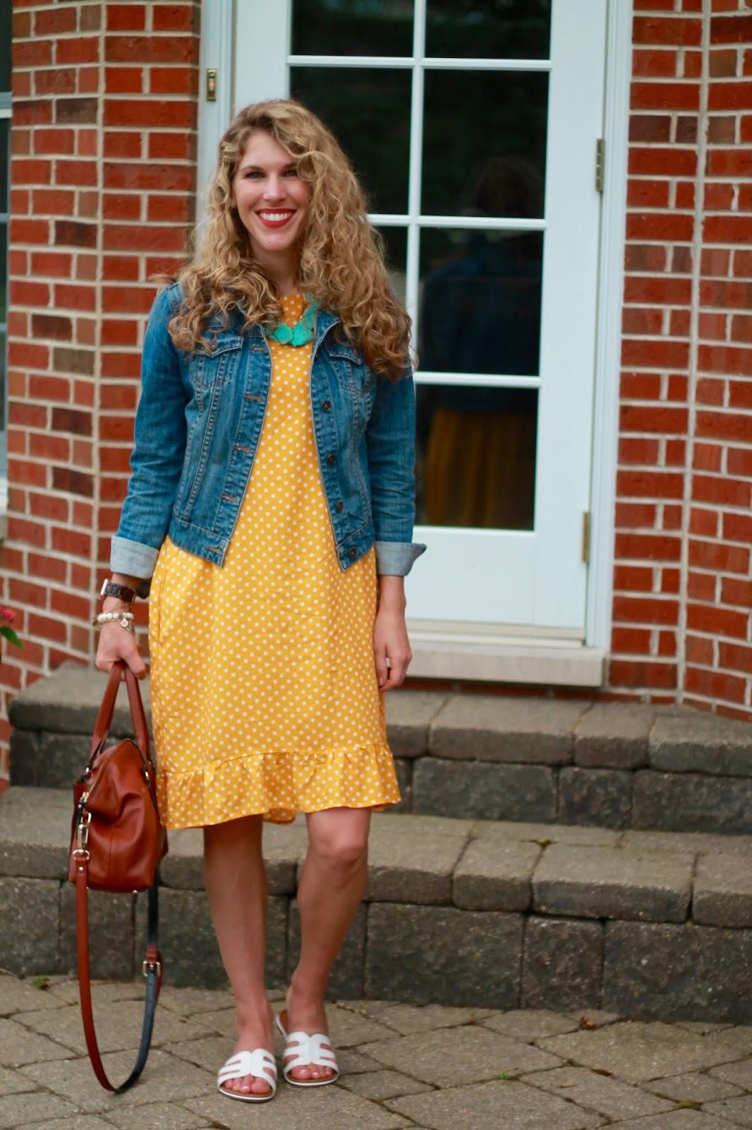 yellow polka dot dress, denim jacket, white slides, cognac satchel, turquoise necklace