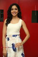 Actress Ritu Varma Stills in White Floral Short Dress at Kesava Movie Success Meet .COM 0038.JPG
