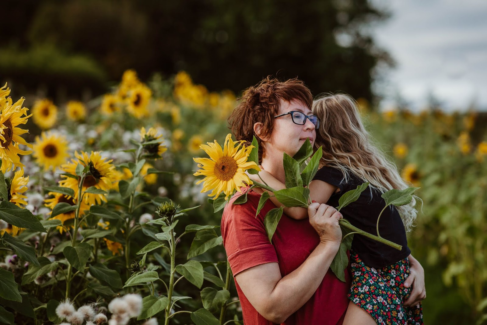 mother and child in sunflowers