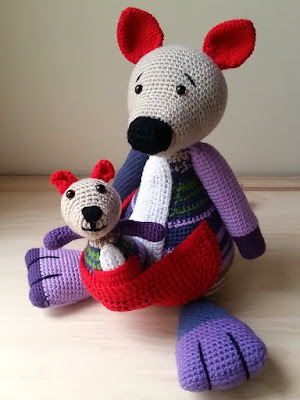 Cheeky crocheted joey looks like she might jump out of mother's pouch to greet you!