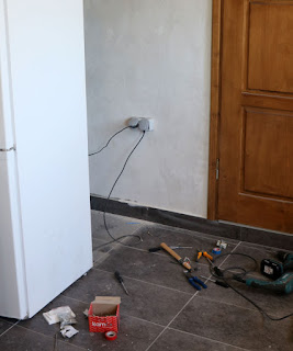 The really dodgy plug behind the fridge is sorted