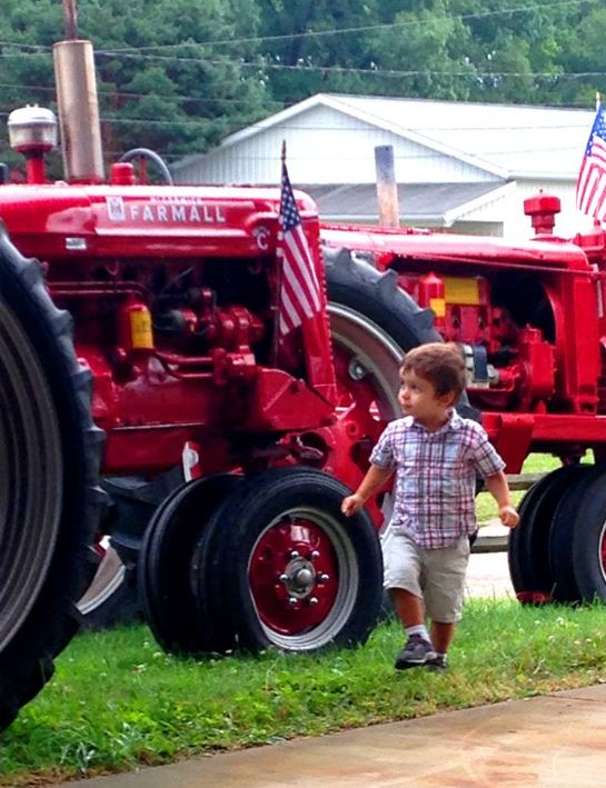 Tractor Going Right On Man : Just a car guy looks like fan of tractors right there
