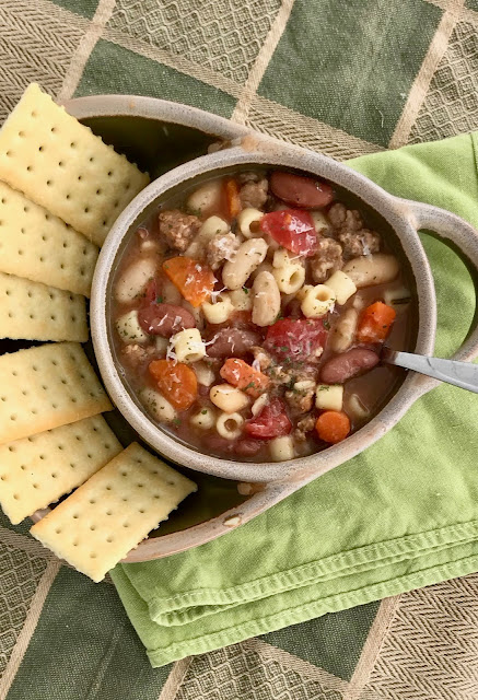 Hearty, warming, and delicious soup is what you need on a cold winter day. This slow cooker soup is full of vegetables, beans, sausage, and pasta for a complete and filling meal.
