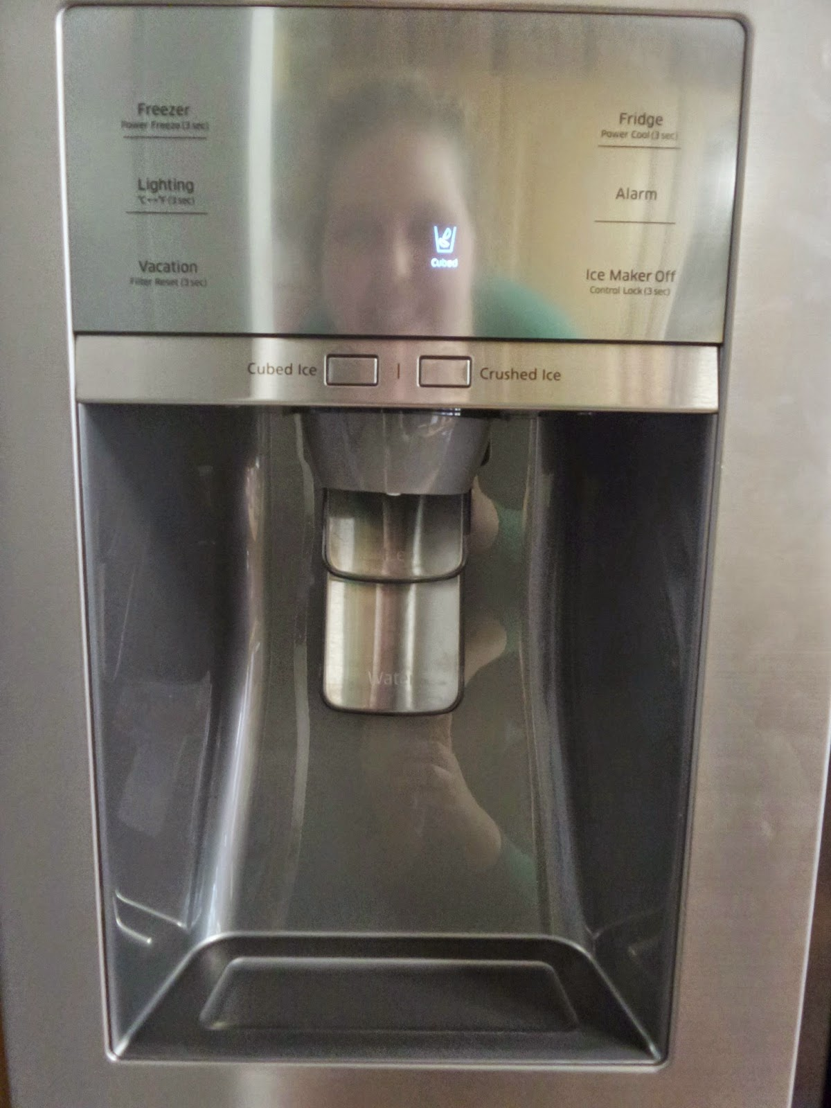 Ice and Water Dispenser in Samsung Showcase Fridge Freezer