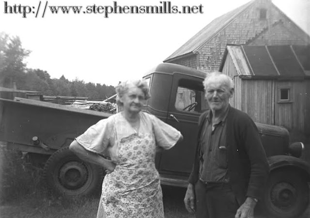 Photo of Alice Hayes Emmons Foster and Luther Henry Foster  at their farm in Madison, Maine