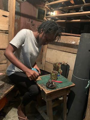 Female student making shoe in ibadan