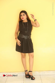 Tollywood Upcoming Actress Pooja Roshan Stills in Black Short Dress at Plus 1 Movie Trailer Launch  0229.JPG