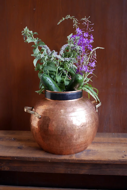 Copper vase with plant ingredients for Deschampsia Apothecary