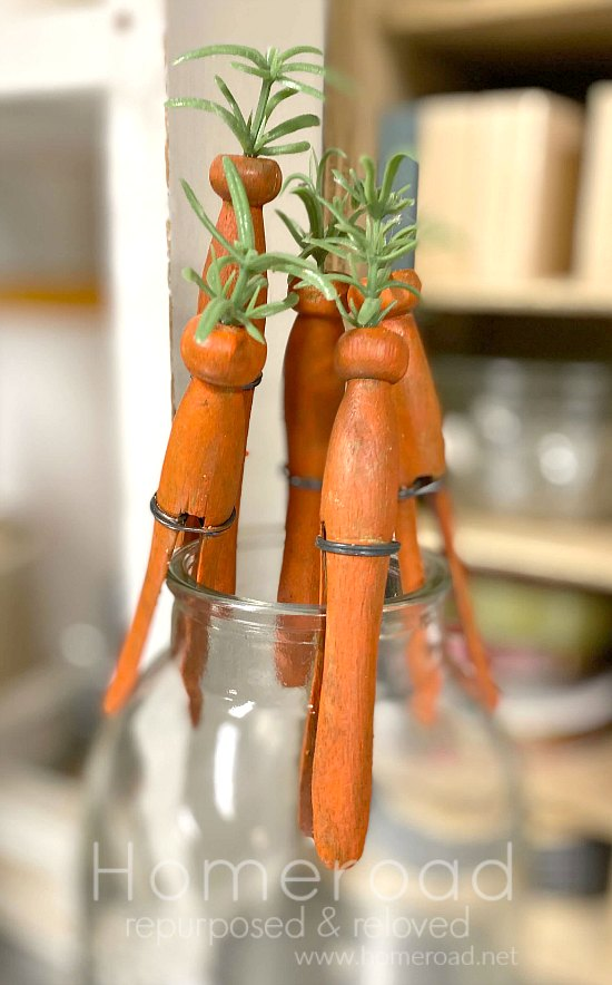 Clothespin carrots drying on a bottle