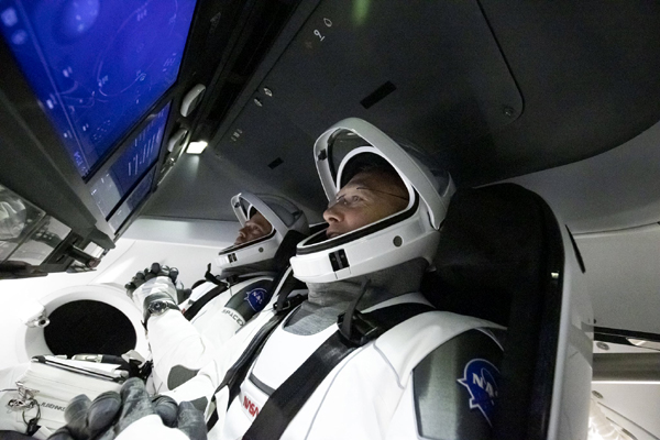 Demo-2 astronauts Doug Hurley and Bob Behnken are seated for flight inside their Crew Dragon vehicle at Launch Complex 39A...on May 27, 2020.
