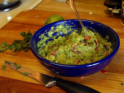 Yum! This tasty avocado dip is also known as _______. (image)