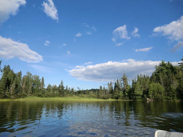boating along an inland lake in northern ontario