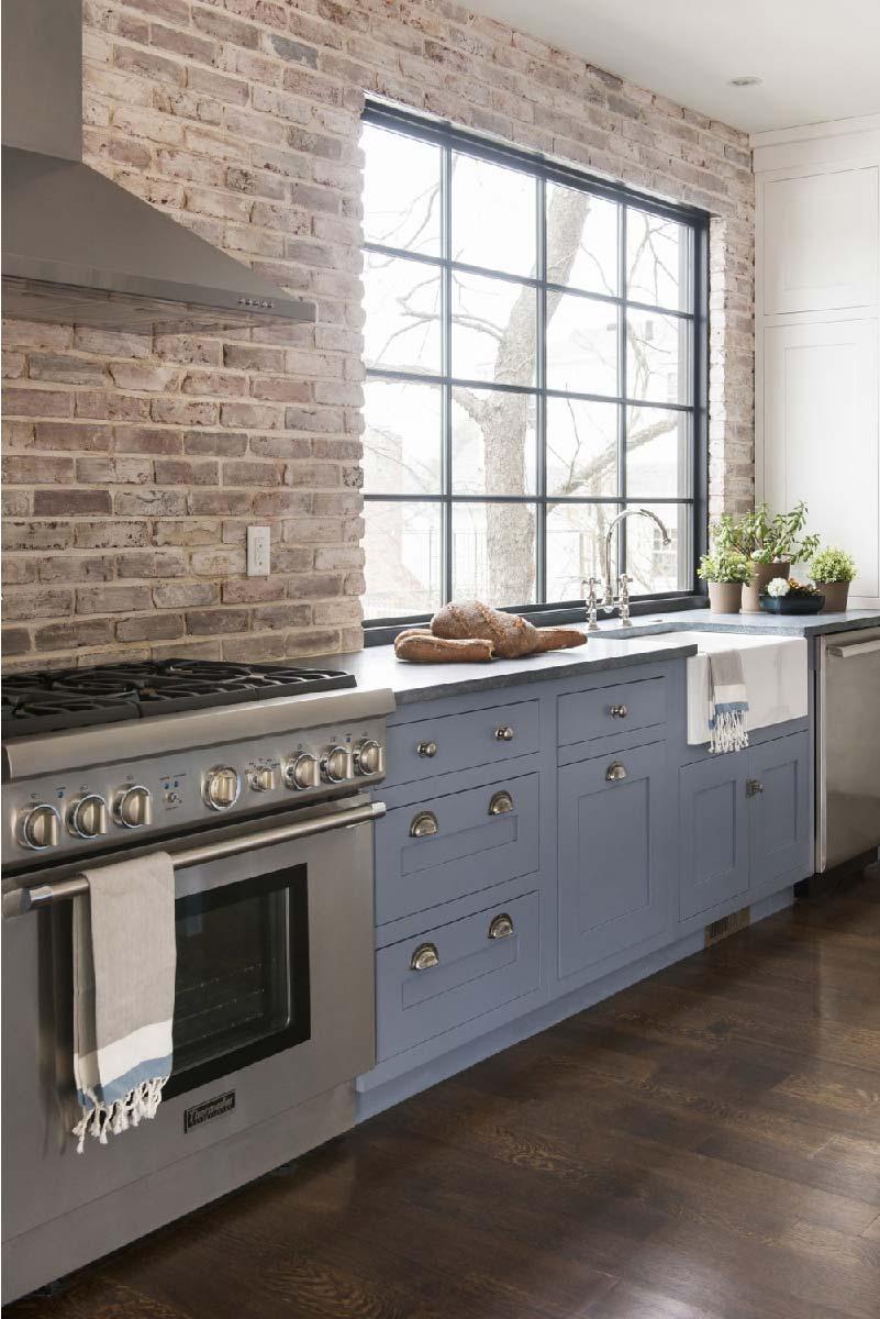 Lasciati ispirare dal fascino delle pareti di mattoni a vista in cucina