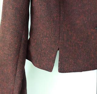 Zo ziet een split van een jasje eruit Deze is zonder onderslag.