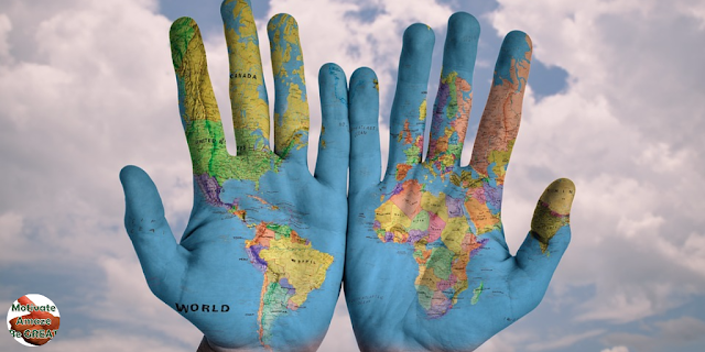 "Featured in the article: ""7 ""Starts & Stops"" Everyone Should Do In Their 20s"". Stop being comfortable, visit a new continent. Human hands with continents painted."