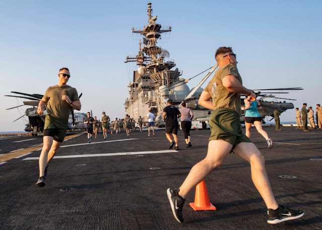 ailors and Marines aboard amphibious assault ship USS Boxer run during a Labor Day 5K held on the flight deck during exercise Eager Lion in the Red Sea, Sept. 1, 2019.
