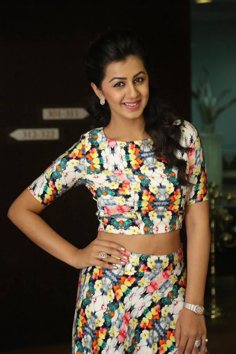 Nikki Galrani Stills Latest Photoshoot In White Dress