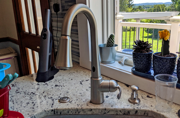 image of the faucet in my kitchen, with two sensors — one at the base, and one on top