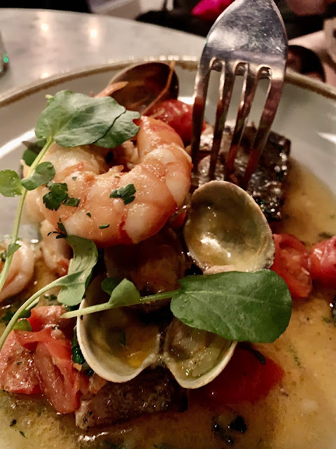 Sea bass with clams and prawns