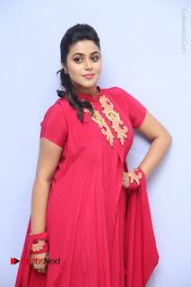Actress Poorna Latest Stills in Red Dress at Rakshasi First Look Launch  0119.JPG