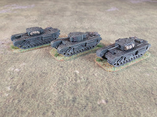 Three Churchill Mark III tanks