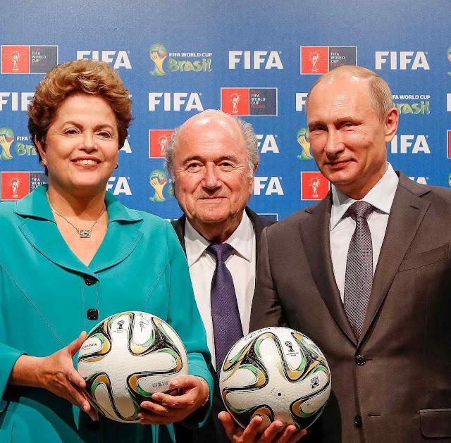 Trilogia da corrupção, e da ideologia?. No Rio, Dilma (Blatter no centro) entrega a preparação da Copa a Putin