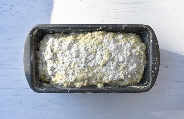 Making Pesto Beer Bread - Step 6 - bread dough in loaf tin topped with flour