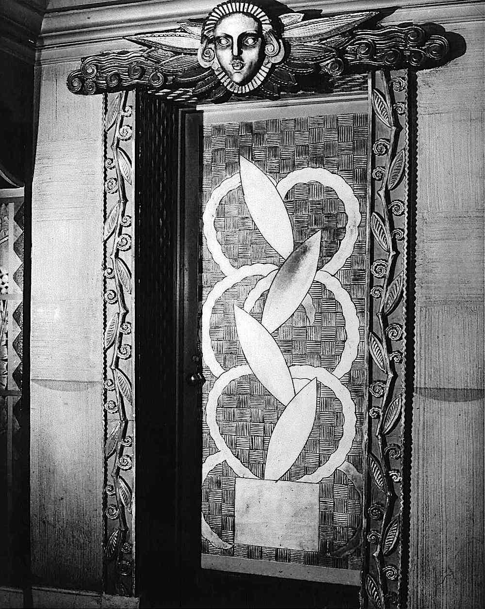 an old metal elevator door