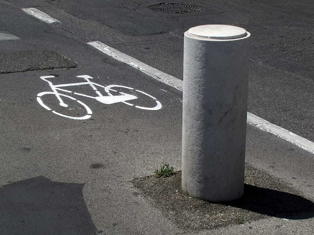 Concrete bollard in the cycle lane, Livorno