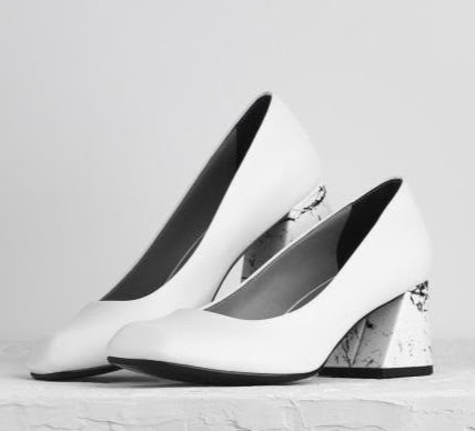 White shoe trend- mid-heel pumps