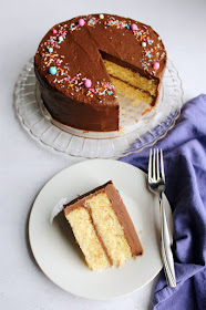 looking down on french butter cake with thick fudge frosting on top. Slice served on dessert plate
