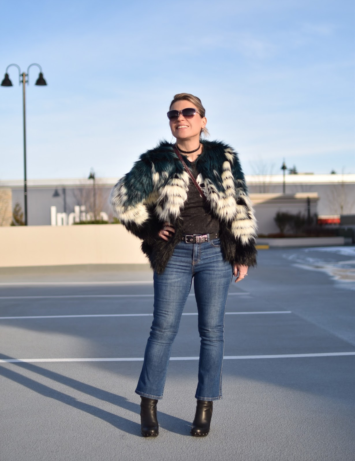 Monika Faulkner outfit inspiration - styling a skull-motif tee with cropped flare jeans, platform booties, and a faux-fur jacket