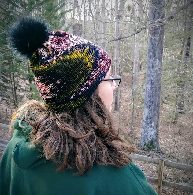 Hemmed brim hat with fur pompom or poof, hand knit with bulky weight wool.