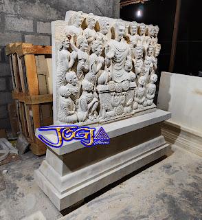 Relief budha terbuat dari batu alam putih jogja (batu paras)