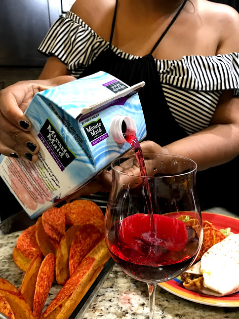 Image: Mom poring a glass of minute maid grape juice