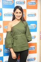 Pragya Jaiswal in a single Sleeves Off Shoulder Green Top Black Leggings promoting JJN Movie at Radio City 10.08.2017 122.JPG