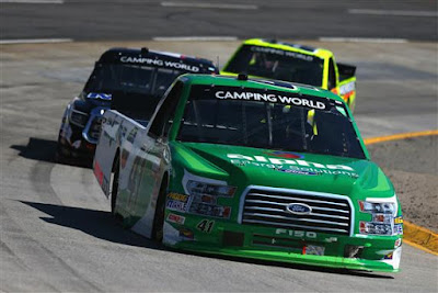 Ben Rhodes, driver of the #41 Alpha Energy Solutions Ford, leads  a pack of trucks during the weather delayed Alpha Energy Solutions 250
