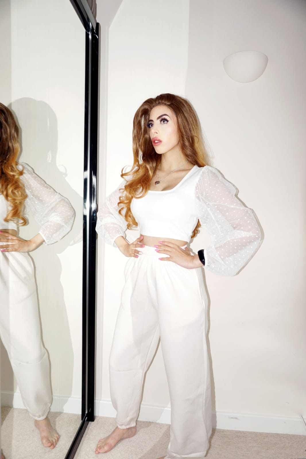 Femme Luxe Off White Cuffed Joggers in model Lizzie.