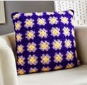 http://www.letsknit.co.uk/free-knitting-patterns/easy-crochet-granny-square-cushion