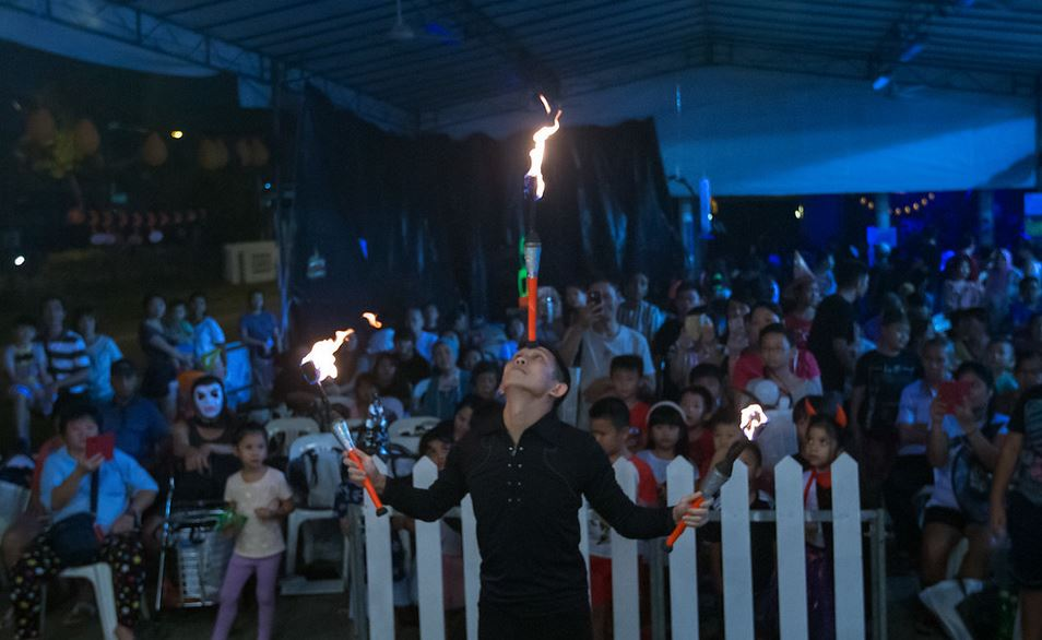 Jimmy Juggler performs Fire Juggling with skill and courage.
