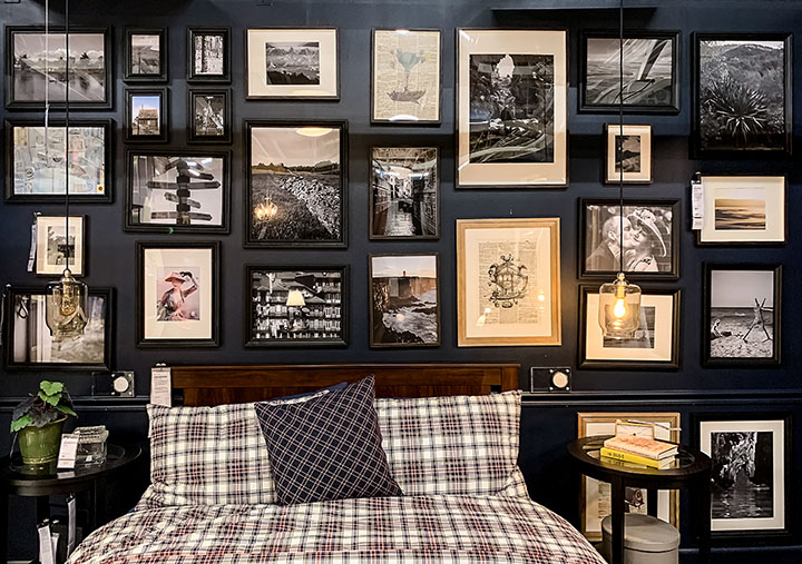 moody bedroom with gallery wall
