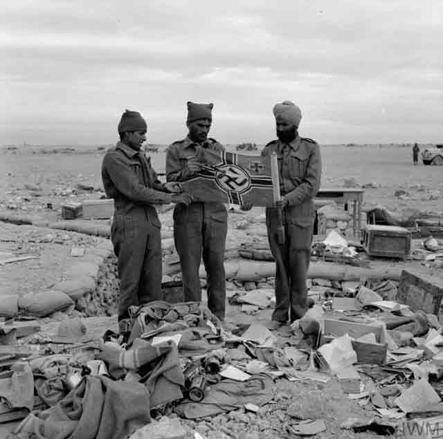 Indian troops in North Africa find a German flag, 24 November 1941 worldwartwo.filminspector.com