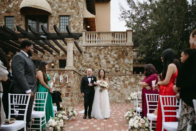 bride and dad walking into ceremony