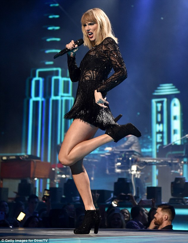 Taylor Swift makes a leggy performance at pre-Super Bowl party