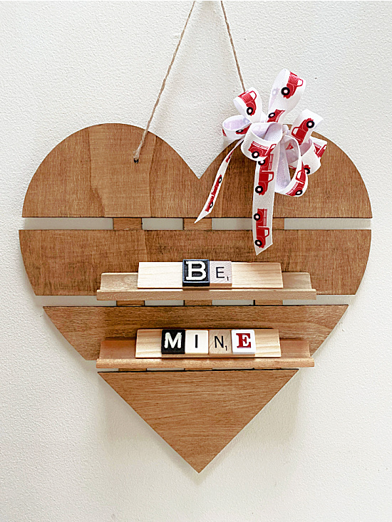 Be Mine Scrabble letters on a heart sign with truck bow