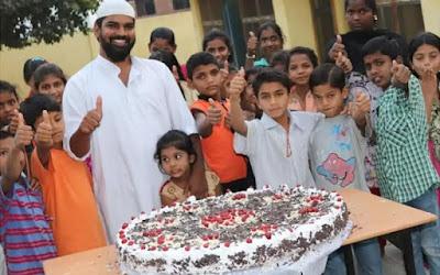 Khwaja Moinuddin feeding to orphans