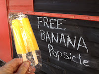 Free Banana Popsicle, courtesy of FryDeez. August temperature over 100 degrees F.