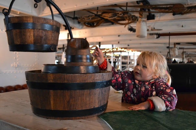 Tin Box Tot sat at a table on HMS Warrior