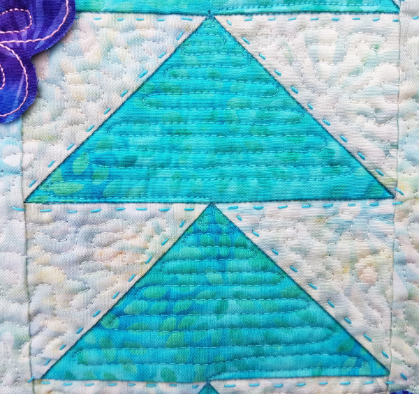 free motion quilting in flying geese   DevotedQuilter.com