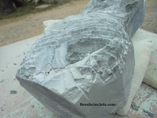 Examining cracks in marble for stone carving
